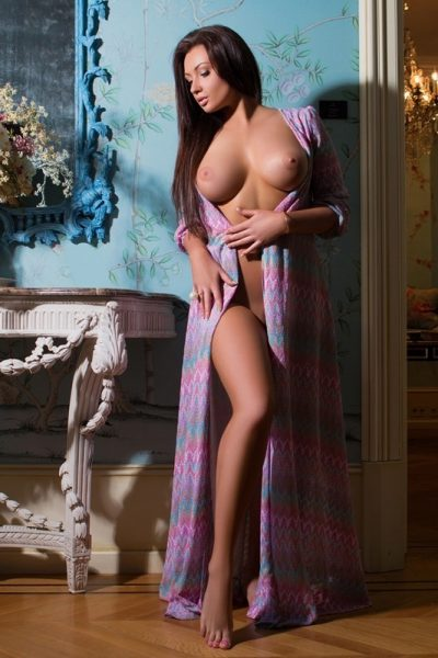 european escort with amazing breast in purple gown