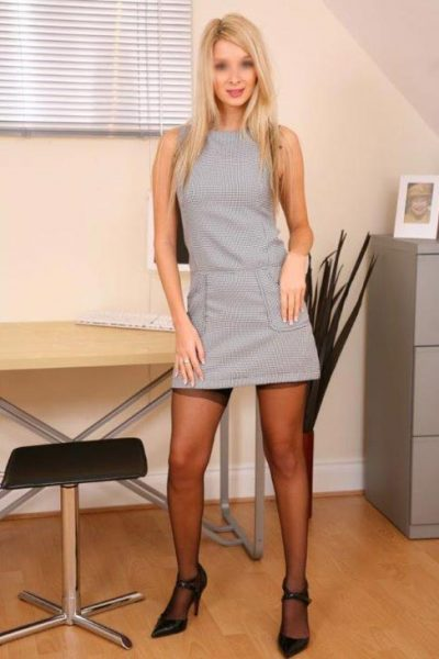 blonde poses in an office