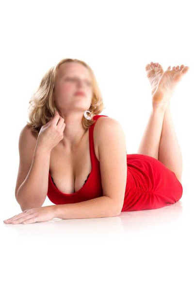 blonde laid on her stomach in a red dress