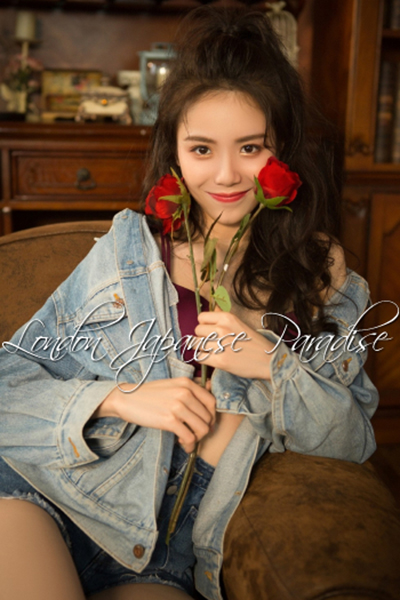 chinese escort in denim jacket holding a red rose