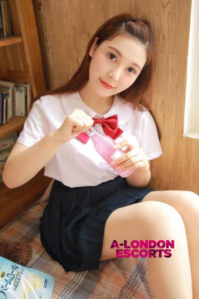 japanese schoolgirl opening a fizzy drink
