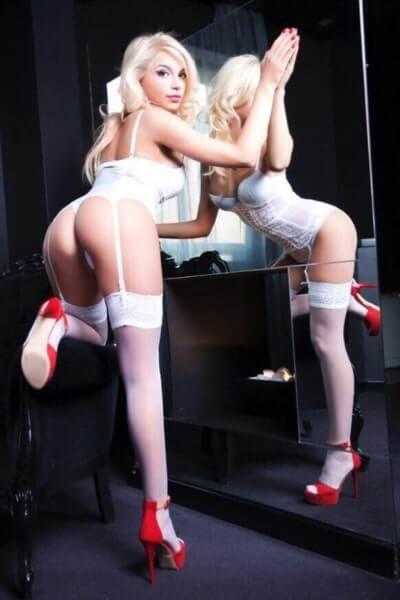 sexy blonde in white underwear and red heels