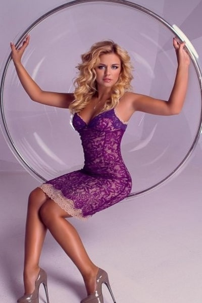 blonde with gorgeous blonde hair in purple dress