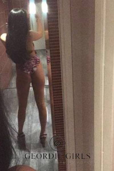 cute girl showing her small ass in the mirror