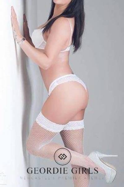 sexy dark haired escort with white heels