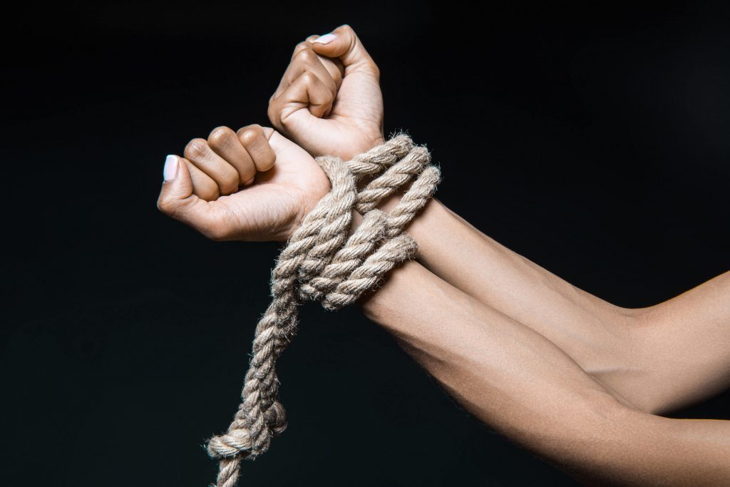womans hands tied with rope