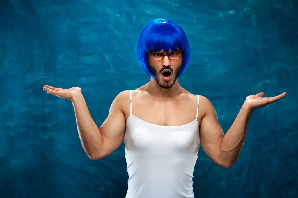 male cross dresser with a blue wig