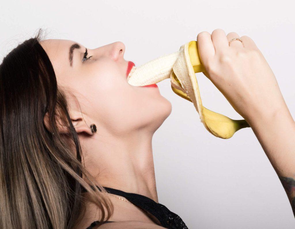 woman deep-throating a banana
