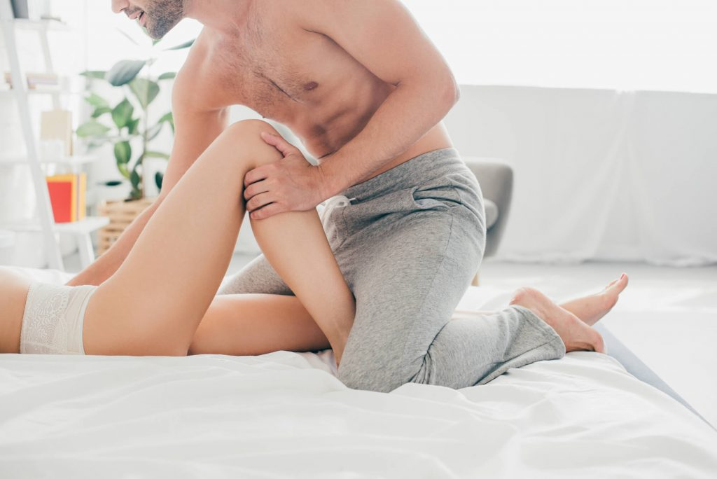 man taking a woman on the bed