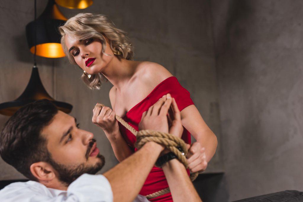 classy girl tying up a sexy man