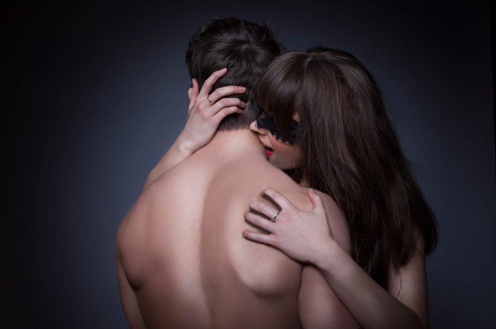woman biting mans neck