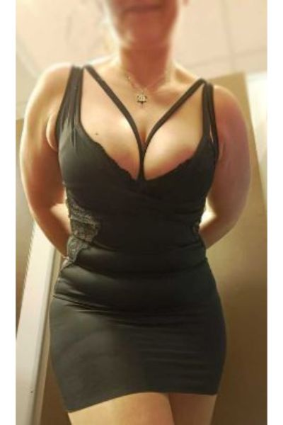 big breasts showing in a black dress
