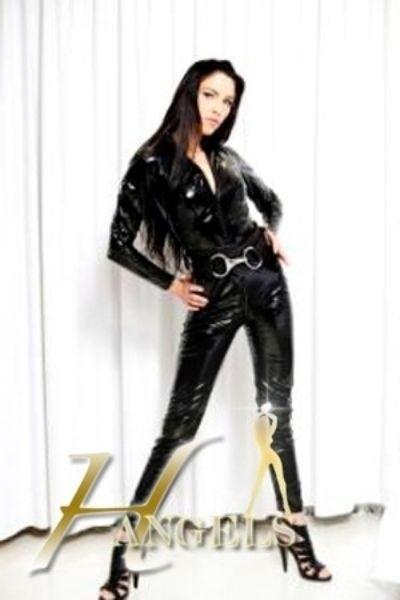 escort in full leather body suit