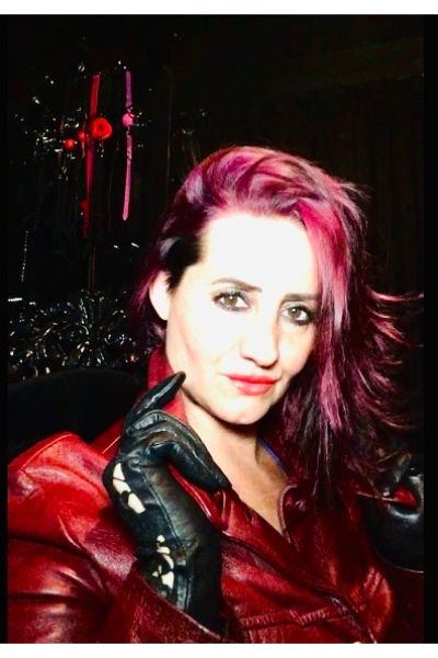 red haired dominatrix
