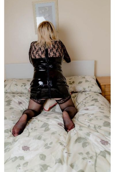 rear shot of blonde mistress in leather