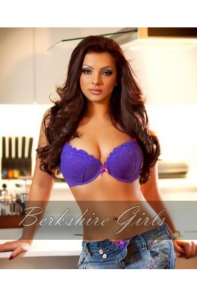gorgeous escort shows off breasts in purple bra