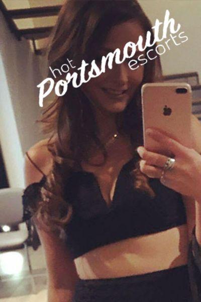 smiling brunette takes a selfie