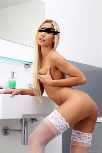 topless blonde in the bathroom in white stockings