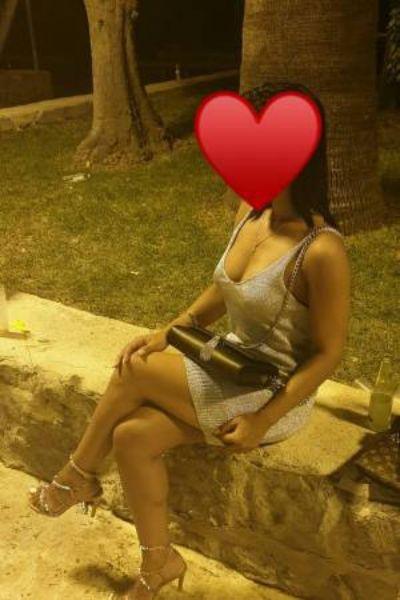senorita sat on a wall in spain