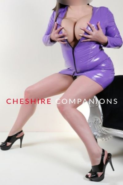 busty woman in purple latex outfit