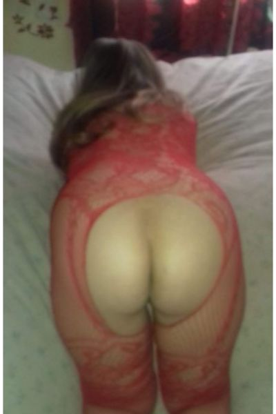 Companion in red outfit with hole bending over