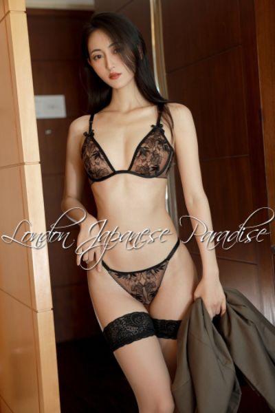 Slim Japanese escort in lingerie