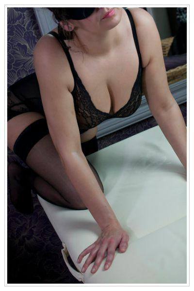 busty brunette in black bending over