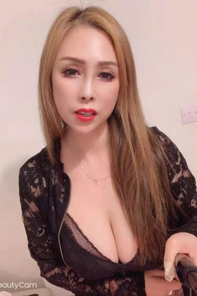 asian babe takes picture with selfie stick
