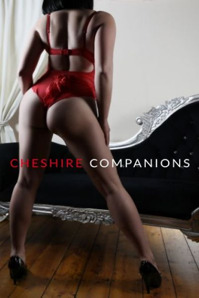 brunette with big full ass poses in red lingerie