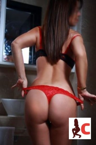 sexy curvy escort in red thong teasing