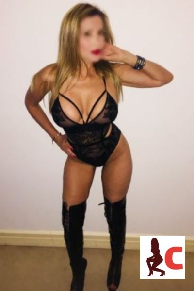 curvy companion poses in black outfit