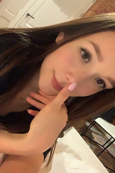 young pretty escort with pink nail polish