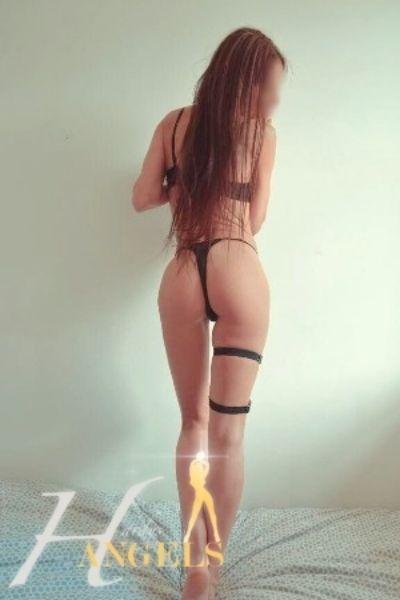 long haired brunette in tight black lingerie