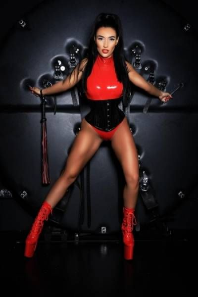 leggy escort in red latex outfit