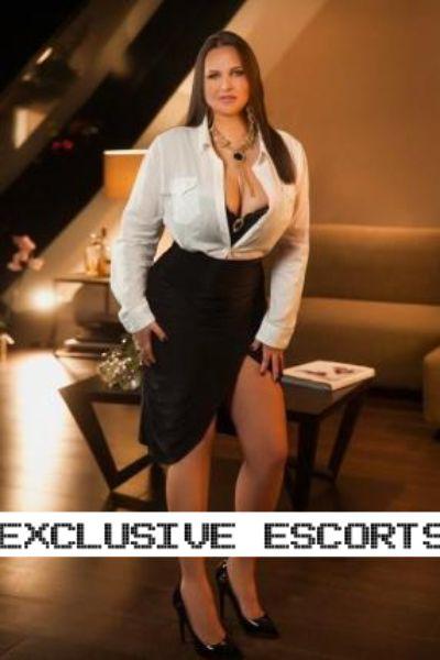 curvy escort in slutty office wear