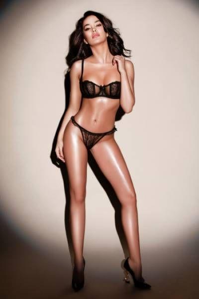 oiled up beauty posing in underwear